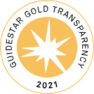 """A white star on a circular golden background, framed by the words """"GuideStar Gold Transparency 2021""""."""